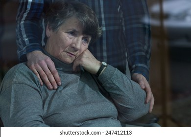 Senior depressed woman and her supportive son