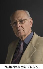 Senior distinguished business man over dark background