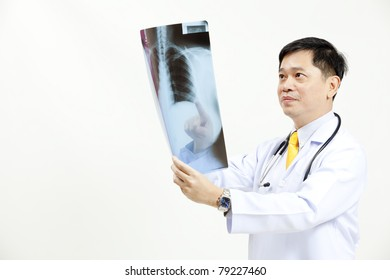 Senior doctor checking xray results