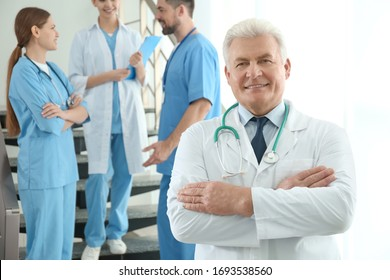 Senior doctor and colleagues in hospital. Medical service