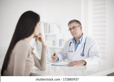 senior  doctor consulting female patient