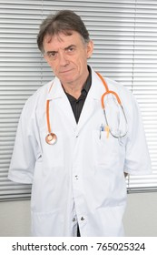 senior doctor with his blouse and stethoscope around his neck