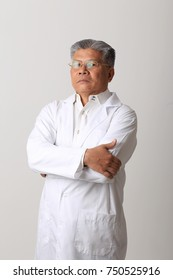 Senior doctor on the white background.