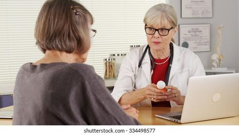 Senior doctor patient giving prescription medication