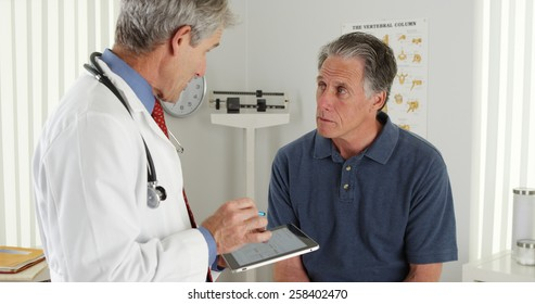 Senior doctor and patient talking in the office