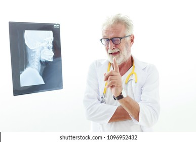 Senior doctor portrait  and skull x-ray with white background