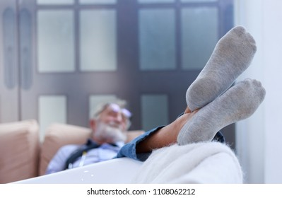 Senior doctor sleeping on sofa after hard work all day. Doctor relax in office