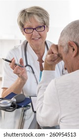 senior doctor talking to her male patient at office