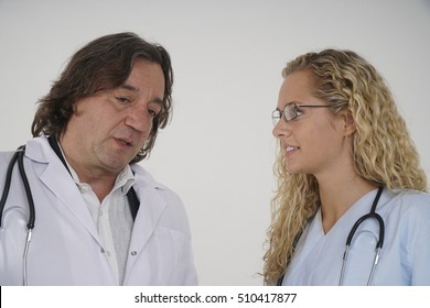 Senior doctor talking to his young and beautiful trainee