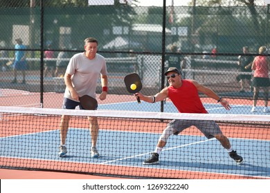 a senior doubles team competes in a pickleball tournament