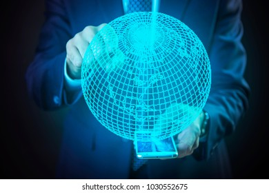 Senior elderly business man projecting the globe from his phone, choosing his next travel destination