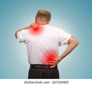 Senior elderly man with lower and upper back pain isolated on light blue background. Spinal cord problems