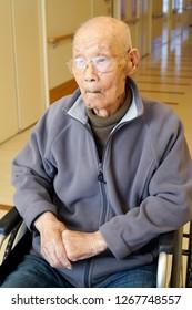 senior or elderly man sitting on wheelchair in nursing home