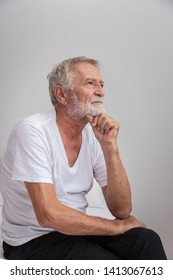 Senior elderly man sitting on bed with depressed after waking up in morning