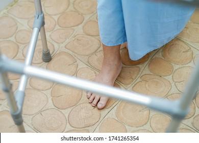 ชAsian senior or elderly old lady woman patient walk with walker in toilet at nursing hospital ward : healthy strong medical concept