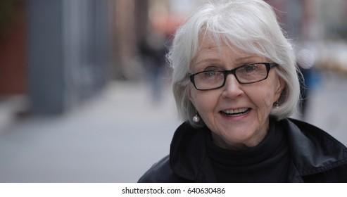 Senior elderly woman in city face portrait