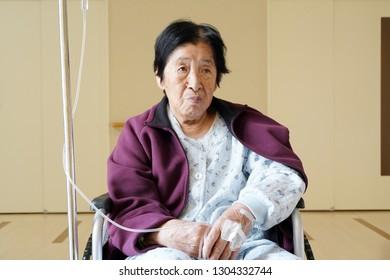 senior or elderly woman sitting on wheelchair in hospital