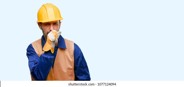 Senior engineer man, construction worker sick and coughing, suffering asthma or bronchitis, medicine concept isolated over blue background