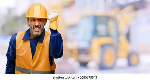 Senior engineer man, construction worker irritated and angry expressing negative emotion, annoyed with someone at work