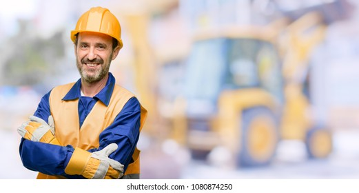 Senior engineer man, construction worker with crossed arms confident and happy with a big natural smile laughing at work