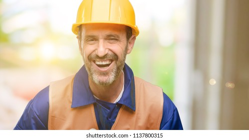 Senior engineer man, construction worker confident and happy with a big natural smile laughing