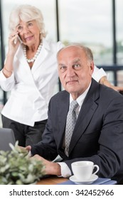 Senior executive businessman working on laptop in office