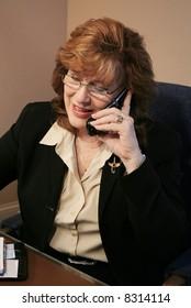 Senior Executive Woman talking on cell phone