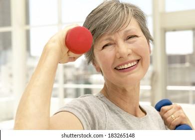Senior exercising at gym