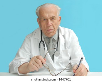 Senior family doctor with stethoscope