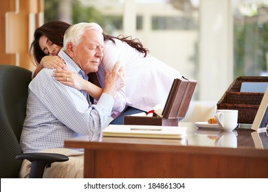 Senior Father Being Comforted By Adult Daughter