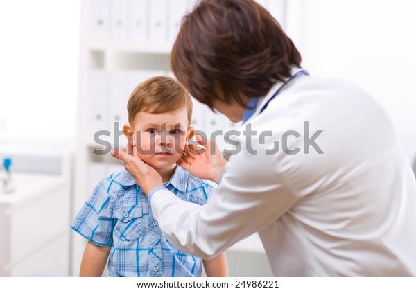 Female Doctor Examining Kid Little Child Boy Stock Photo