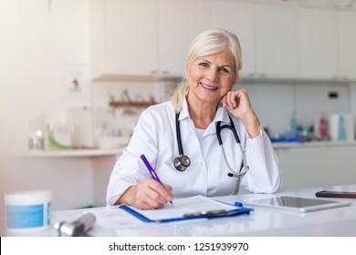 Senior female doctor smiling at the camera