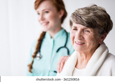 Senior female patient and supporting female doctor