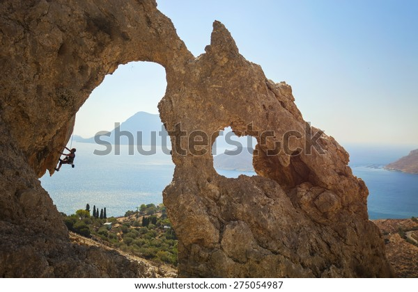 Mixed Race Girl Rock Climbing On Cliff High-Res Stock