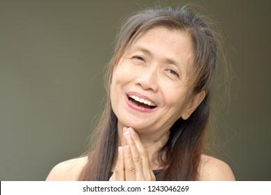Senior Filipina Woman Praying