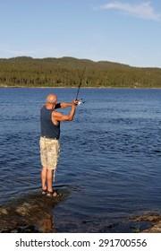 Senior fishing by a lake