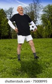 Senior football player in the park