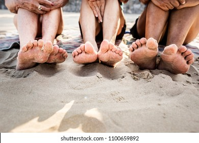 Senior friends enjoying the beach in the summertime