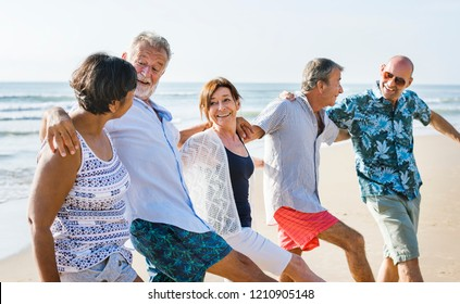 Senior friends playing at the beach