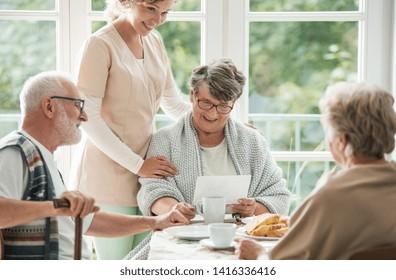 Senior friends spending time together at nursing home