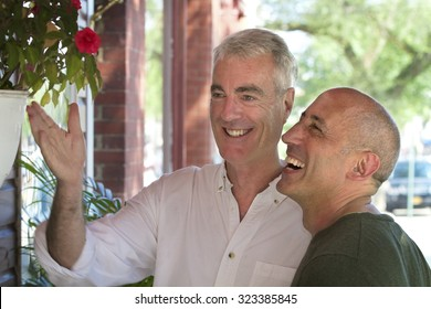 Senior Gay Male Couple Window Shopping in Small Village in The Hamptons