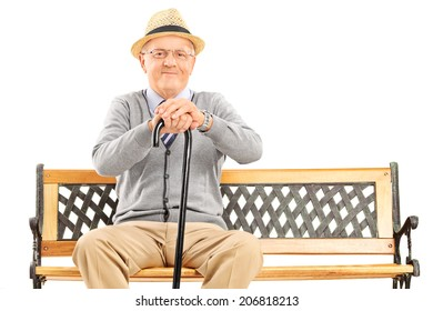 Senior gentleman with a cane sitting on bench isolated on white background