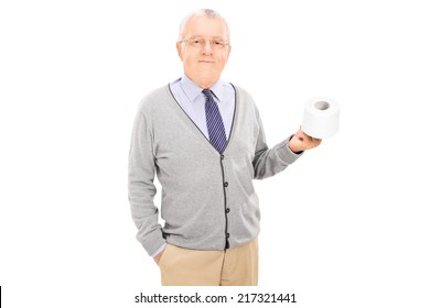 Senior gentleman holding a toilet paper roll isolated on white background