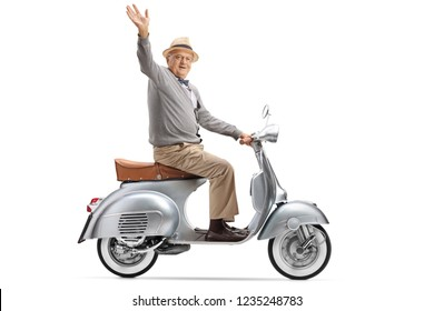 Senior gentleman riding a vintage scooter and waving at the camera isolated on white background