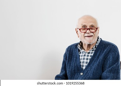 Senior gentleman in the studio on a white background, blue sweater