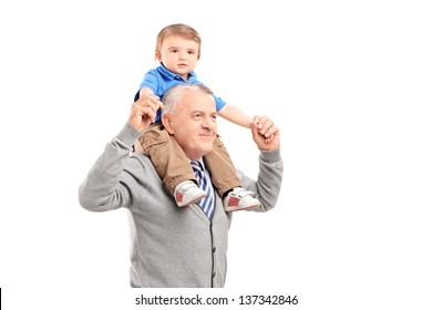 Senior giving a piggy back ride to his grandson isolated on white background