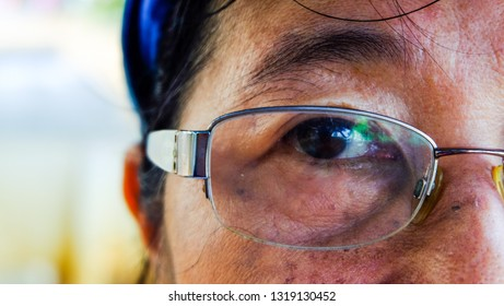 senior with glasses. vision and old people concept, close to the face and eyes of an Asian old women