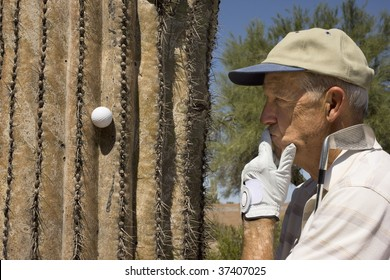 Senior golfer pondering a bad lie on a summer day in the Southwest USA.