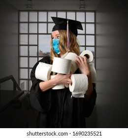 A senior graduate from the class of 2020 is graduating inside holding toilet paper as a humorous portrait concept.