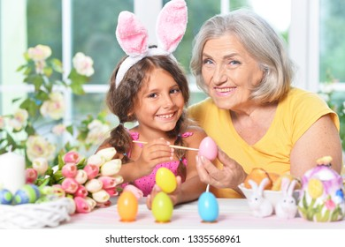 Senior grandmother and granddaughter with  Easter eggs